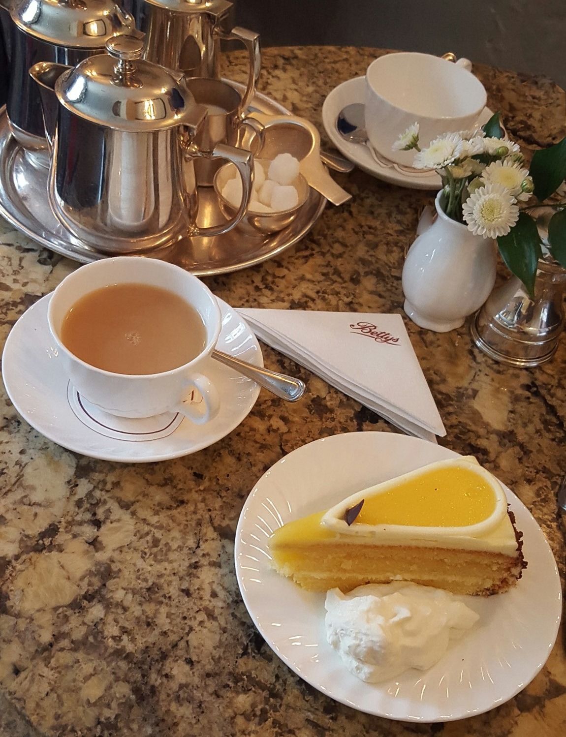 Tea and a delicious lemon cake with a dollop of cream