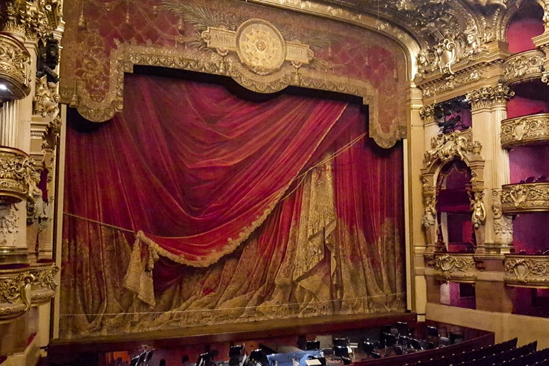 The auditorium of Palais Garnier showing the magnificent tromp l'oeil stage curtain